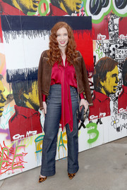 Annalise Basso completed her outfit with a pair of nautical jeans that she paired with Schutz shoes.