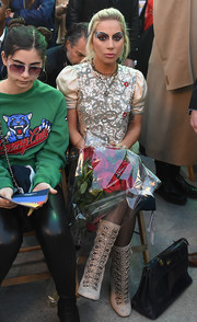 Lady Gaga sat front row at the Tommy Hilfiger show looking all sparkly in a gold sequin top from the label.