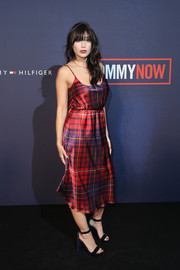 Daisy Lowe looked sultry in a low-cut plaid slip dress by Tommy Hilfiger during the brand's Fall 2017 show.