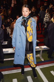 Margaret Zhang's pastel-blue coat contrasted nicely with her yellow suit.