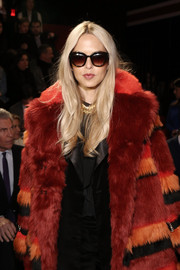 Rachel Zoe hid her eyes behind a pair of tortoiseshell cateye sunnies as she posed for photographers at the Tommy Hilfiger fashion show.