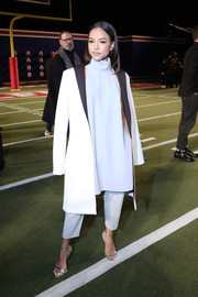 Karrueche Tran was minimalist-chic at the Tommy Hilfiger fashion show in a black-and-white coat layered over a pastel-blue halter dress and matching pants.