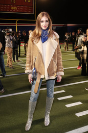 Chiara Ferragni looked toasty and chic in a nude suede jacket by Acne Studios at the Tommy Hilfiger fashion show.