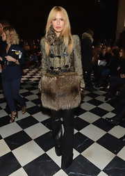 Rachel Zoe, who is known for her hippie-inspired style, rocked a funky fur coat at Tommy Hilfiger's Fall 2013 runway show.
