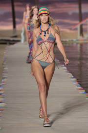 Gigi Hadid looked fun and sexy in a multicolored string bikini at the Tommy Hilfiger Spring 2016 show.