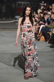 Bella Hadid looked patriotic in her stars-and-stripes maxi dress while walking the Tommy Hilfiger show.