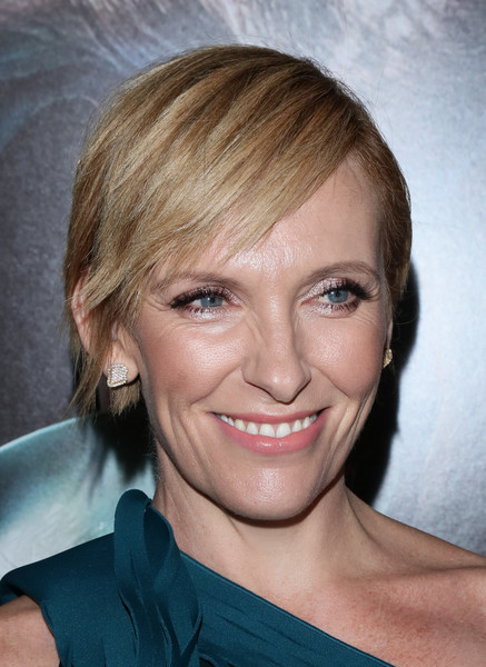 Toni Collette Diamond Studs [hair,face,hairstyle,eyebrow,blond,chin,forehead,lip,cheek,bangs,toni collette,arrivals,screening,krampus,california,hollywood,arclight cinemas,universal pictures,industry screening]