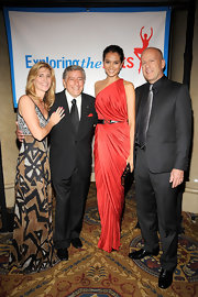 Emma Heming was a fashion stand out this slinky red grecian gown at an arts gala in NYC.