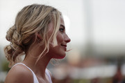 Margot Robbie rocked a messy, knotty updo at the Australian premiere of 'I, Tonya.'