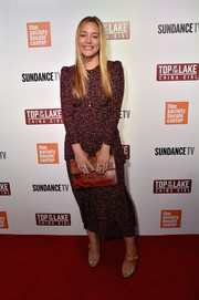 Piper Perabo completed her ensemble with a camel-colored leather clutch.