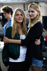 Cara Delevingne was spotted backstage at the Topshop Unique show looking laid-back in a green zip-up jacket.
