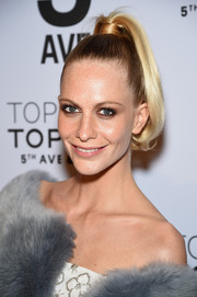 Poppy Delevingne pulled her hair high up into a tight ponytail with wavy ends for the Topman New York City flagship store opening.
