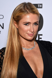 Paris Hilton wore her hair long and straight with the sides clipped back during the Topman New York City flagship opening dinner.