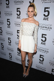 Poppy Delevingne looked darling in a white Topshop Exclusive off-the-shoulder mini, featuring a floral-accented bodice, at the Topman New York City flagship opening dinner.