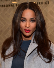 Ciara styled her hair with a center part and barely-there waves for the Topshop holiday season celebration.