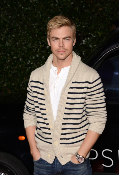 A classic shawl-collar cardigan made Derek Hough's look preppy and casual at the Topshop Topman LA opening.