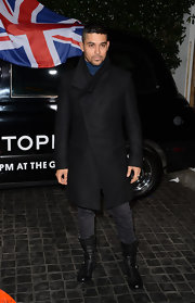 Wilmer Valderrama opted for an all black wool coat with a large, standing collar for the Topshop Topman LA opening.