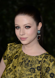 Michelle Trachtenberg added some cocktail-party glam to her youthful dress with gemstone dangle earrings.