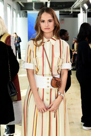 Debby Ryan accessorized with a tiny leather cross-body bag by Tory Burch during the brand's Fall 2019 show.