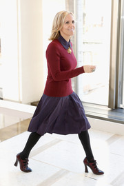 Tory Burch went for a youthful, preppy look with a burgundy crewneck sweater layered over a blue dress during her fashion show.