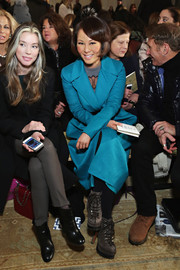 Alina Cho teamed gray lace-up ankle boots with a blue wool coat for the Tory Burch fashion show.