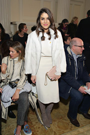 Camila Coelho was chic in her winter whites at the Tory Burch fashion show: a blouse and skirt combo topped off with a fur jacket.