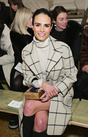 Jordana Brewster attended the Tory Burch fashion show carrying an embellished wooden box clutch.