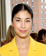Caroline Issa accessorized with a chic pair of dangling crystal earrings at the Tory Burch Spring 2015 show.