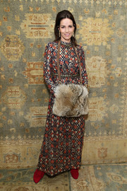 Adriana Abascal proved modest isn't necessarily boring with this long-sleeve floral maxi dress she wore to the Tory Burch fashion show.