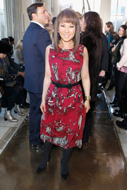 Alina Cho attended the Tory Burch fashion show wearing a sleeveless red print dress.