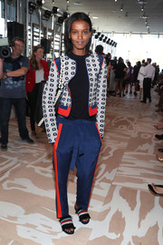 Blue drawstring pants with red side stripes (from the same collection) completed Liya Kebede's outfit.