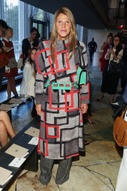 Anna dello Russo was all covered up in a long-sleeve square-print dress and gray slacks during the Tory Burch fashion show.