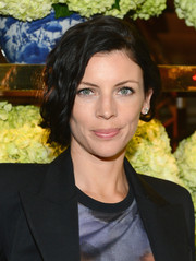 Liberty Ross styled her hair into a romantic updo for the Tory Burch Rodeo Drive opening.