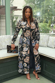 Tiffany Haddish layered a Tory Burch print coat over a pair of jeans for the brand's Spring 2019 show.