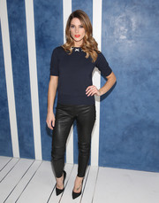 Ashley Greene balanced out her conservative top with edgy-sexy leather skinnies.