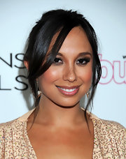 Cheryl Burke arrived at 'InTouch Weekly's' 4th Annual Icons & Idols Celebration with dramatic smoky eyes. A shimmering bronze shadow was layered over a black eyeliner and blended up into the crease then also used to line under the eyes.