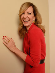 A pair of gold disc earring complemented Allison Janney's dress.