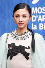 Hikari Mitsushima wore her hair in a simple side-parted braid during the Venice Film Festival premiere of 'Traces of Sin.'
