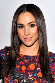 Meghan Markle showed off a perfectly sleek hairstyle at the Tracy Reese fashion show.