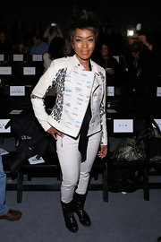 Angela Bassett looked fresh and youthful with white skinny pants at the Tracy Reese runway show.