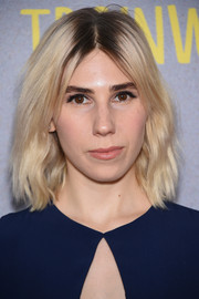 Zosia Mamet sported edgy platinum-blonde waves with dark roots at the New York premiere of 'Trainwreck.'