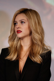 Nicola Peltz chose a bold red lip color for some sexiness to her look.
