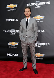 Shia LaBeouf looked fashionable at the 'Transformers' premiere in a patterned gray suit and black tie.