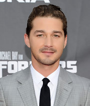 Shia LaBeouf complemented his elegant outfit with a clean slicked-back wavy hairstyle at the 'Transformers' premiere.