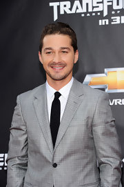 Shia LaBeouf paired a solid black tie with his gray suit for a totally elegant finish.