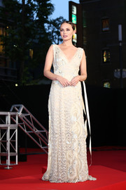 Laura Haddock looked very refined in a cream-colored lace gown by Marc Jacobs at the Japan premiere of 'Transformers: The Last Knight.'