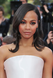 Zoe Saldana swept her brunette tresses to one side at the premeire of 'The Tree of Life.'