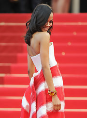 Zoe Saldana paired her striped gown with a bold cuff bracelet that balanced her elegant look with bold color.