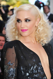 Gwen Stefani looked like a '70s glamazon at the Cannes Film Festival with fluffy curls that were twisted and pinned to one side.