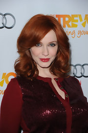 Christina Hendricks wore her hair in soft waves and curls with sexy side swept bangs at The Trevor Project's 2011 Trevor Live!.